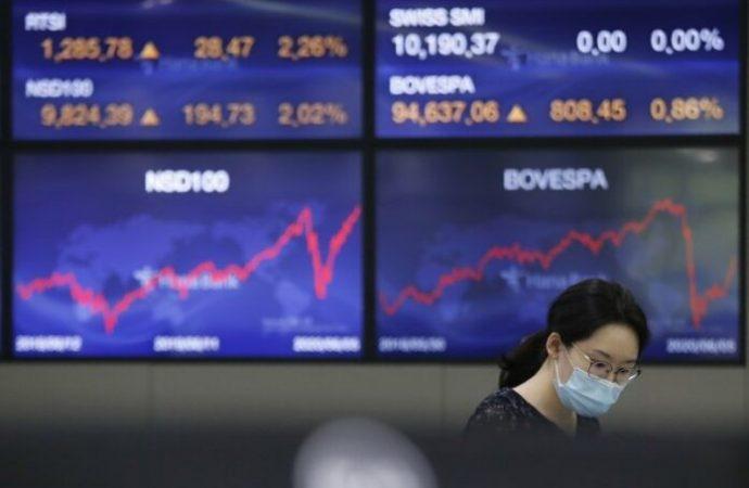 Las acciones suben más ya que Nasdaq alcanza récord en esperanzas económicas